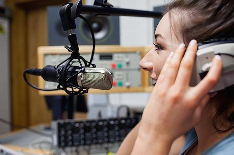 smiling-radio-host-speaking.jpg