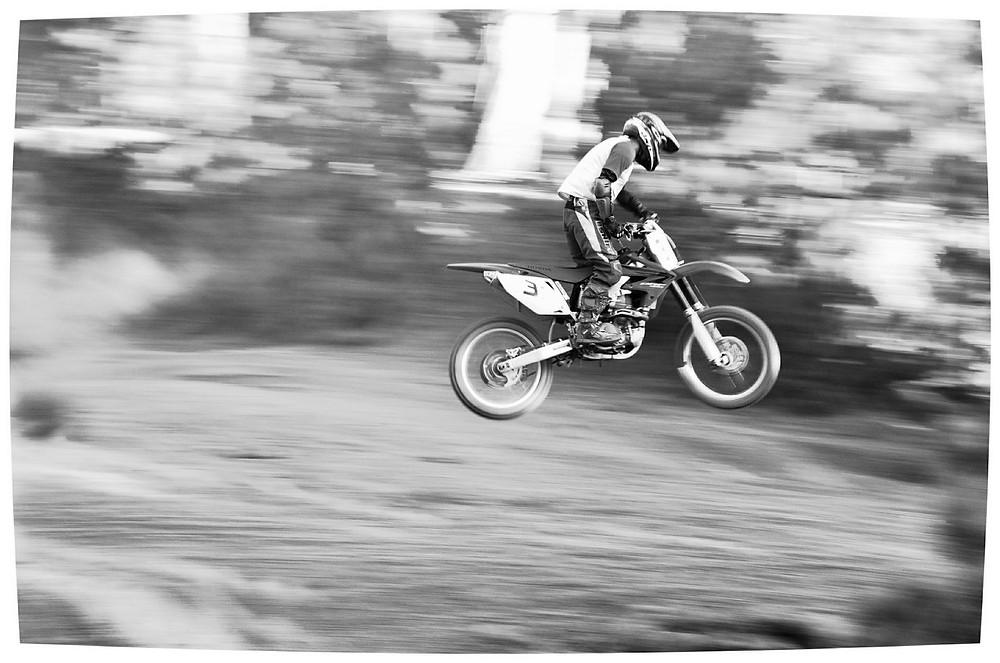 dirt bike rider doing a jump