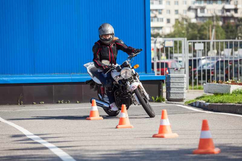 rider doing training on how to ride around cones