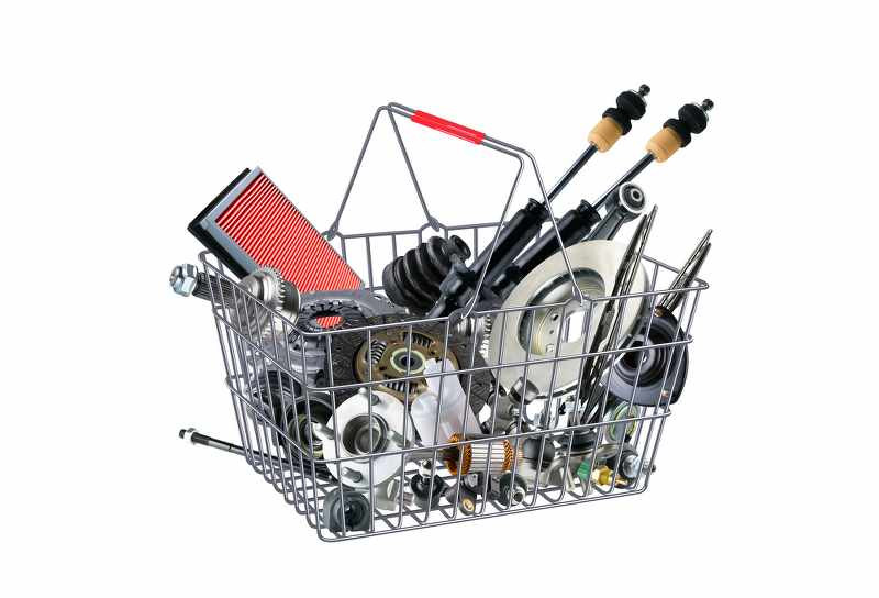 a shopping cart with motorcycle parts inside_800x544