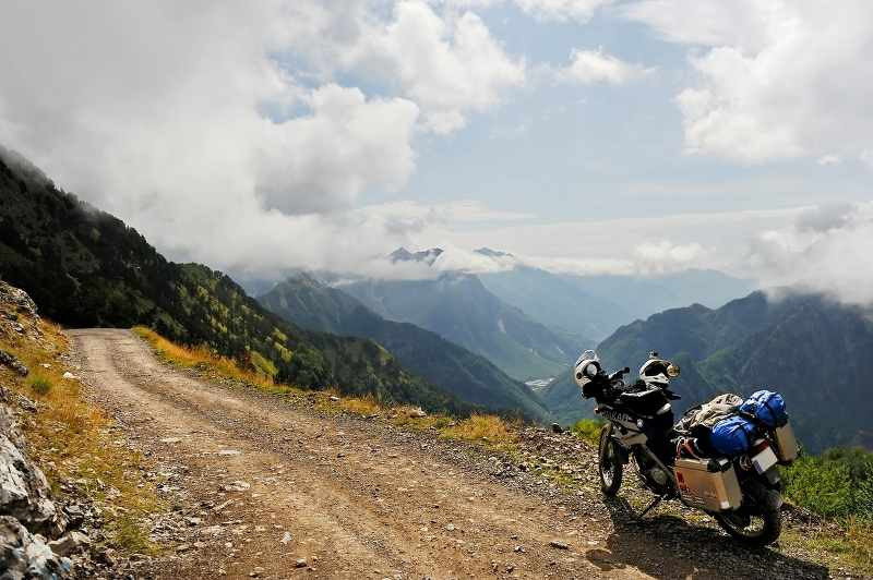 enduro motorcycle on a mountain road with luggage system in place_800x532