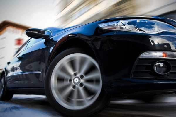 car wheel in motion sedan