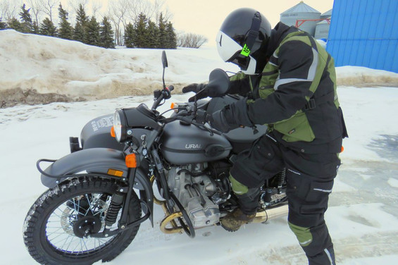 kick starting a ural in the snow and wearing a siima sibirsky suit