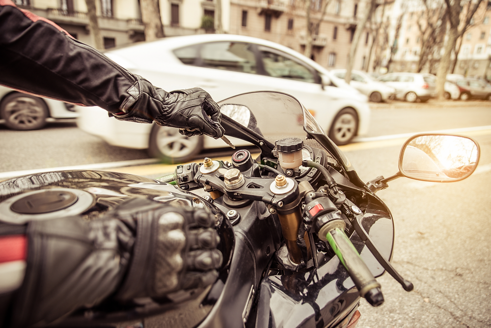 Urban motorcycle rider in traffic