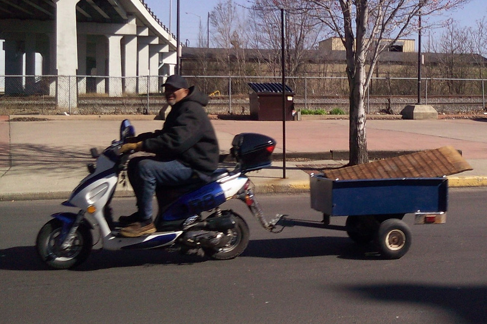 scooter towing a trailer