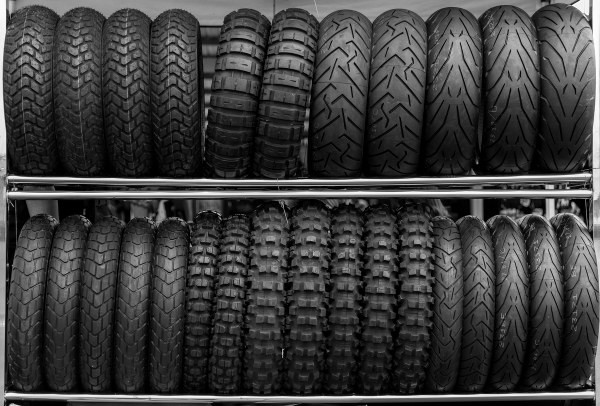 a collection of motorcycle tires on a stand