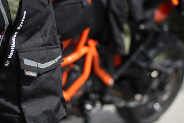 siima sibirsky pants in front of a KTM 1190