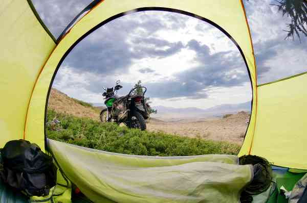 a view of the motorcycle through the tent