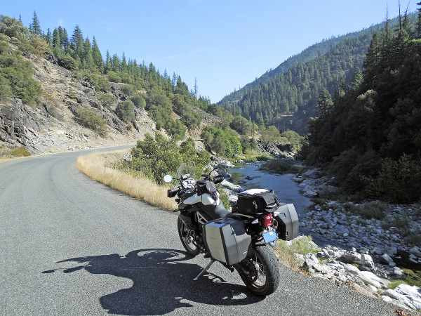 a motorcycle next to the road in between mountains with panniers_600x450.jpg