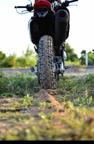 a flat motorbike tire in a field