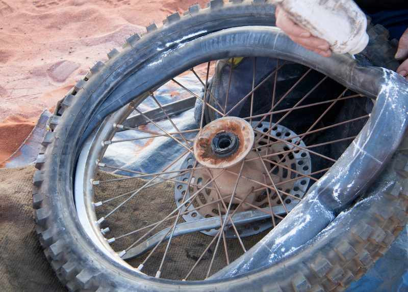 fix a motorcycle tire in the middle of nowhere