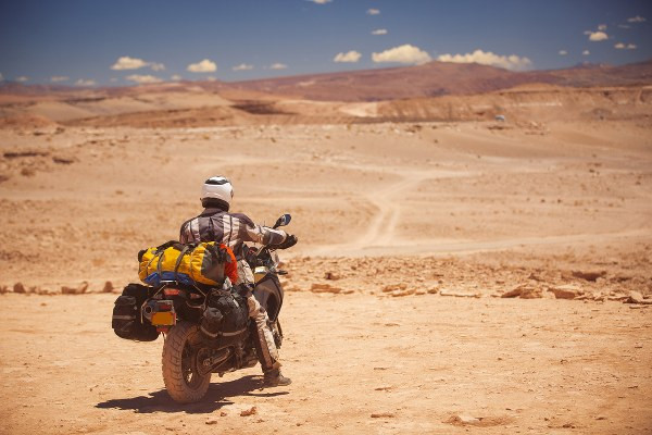 motorcycle and rider on an adventure in the desert
