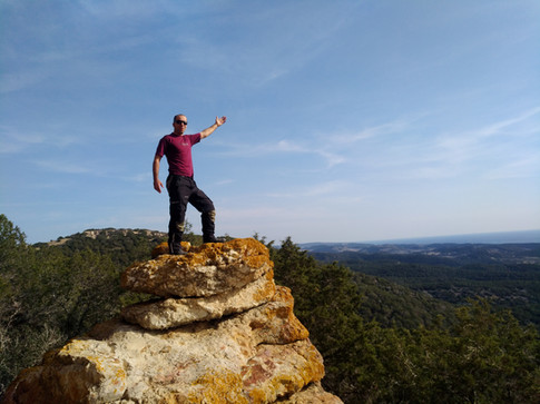 standing on the highest rock wearing siima sibirsky