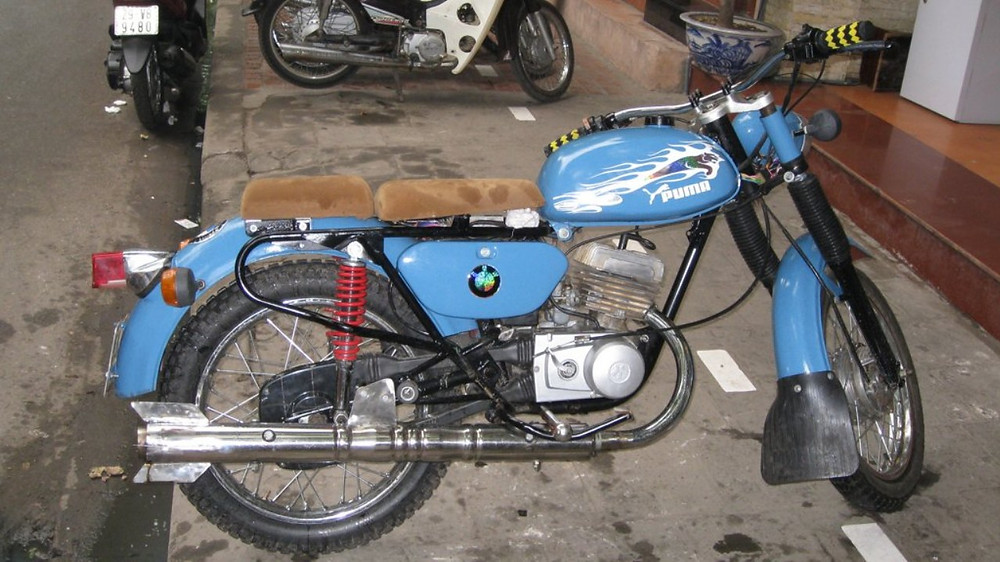 a classic blue bmw motorcycle