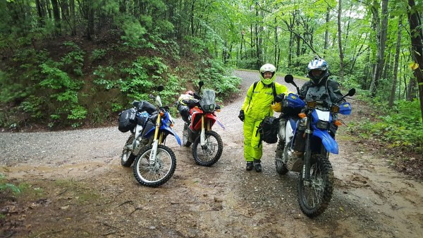 trans america trail with 3 riders and their motorcycles on adventure