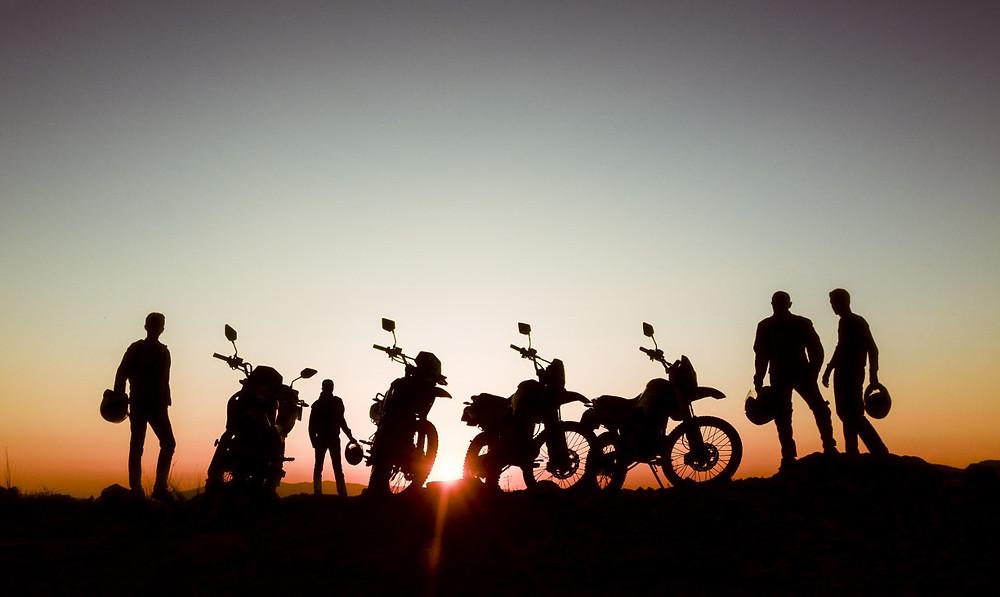 group of riders enjoying sunset
