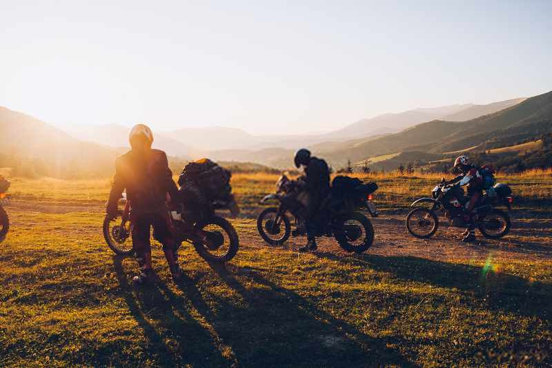 motorcycle riders doing off road in a great landscape_800x534