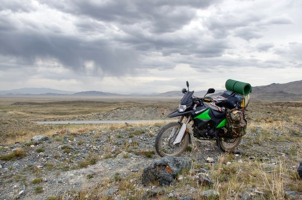 a motorcycle pack ed with lugage and other equipment in the fields