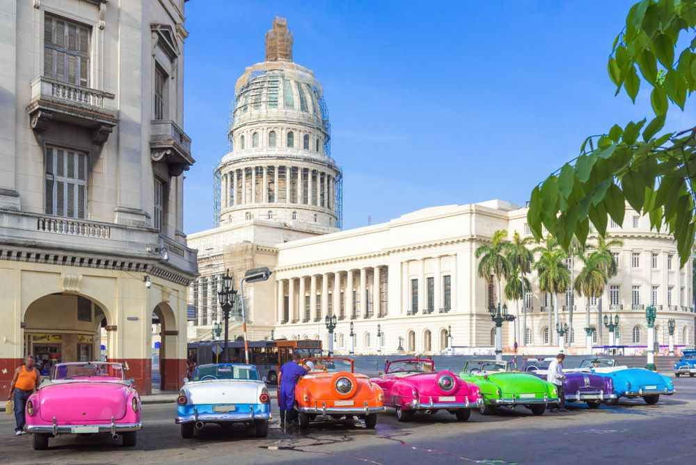 Colorfulamerican vintage cars parked before the Capitolio in Havana City, Cuba