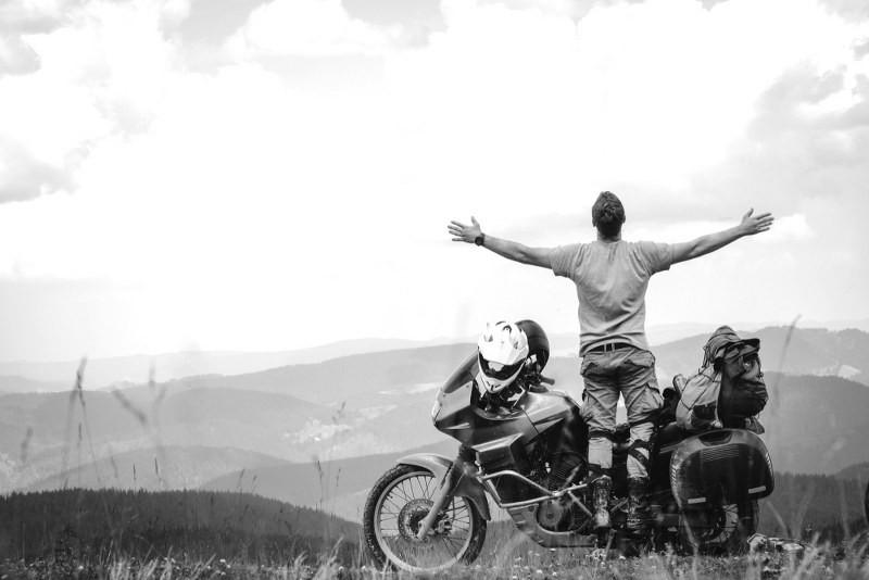 motorcycle adventurer enjoying freedom and solitude
