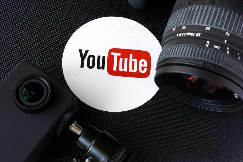 youtube logo with a dslr camera and other photo equipment.jpg