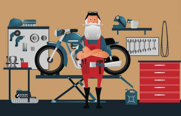 cartoon of motorcycle mechanic standing in front of his motorbike in a garage