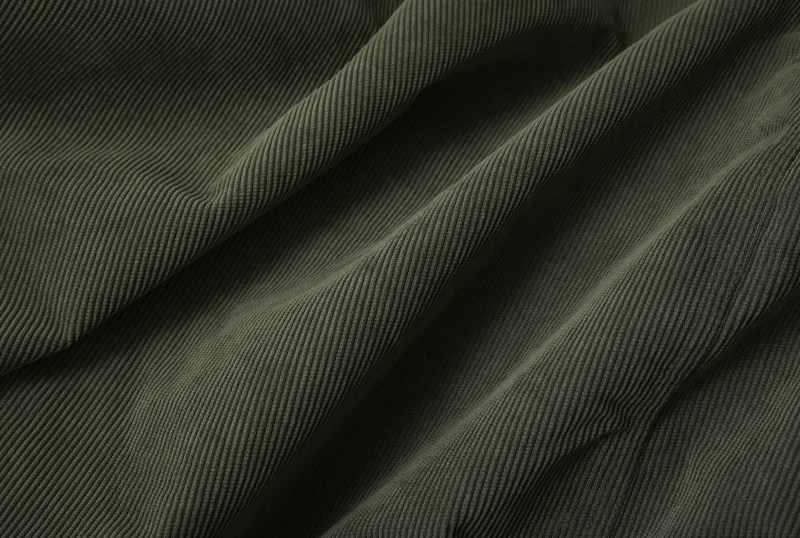 A full page close up of green cord fabric texture_800x538