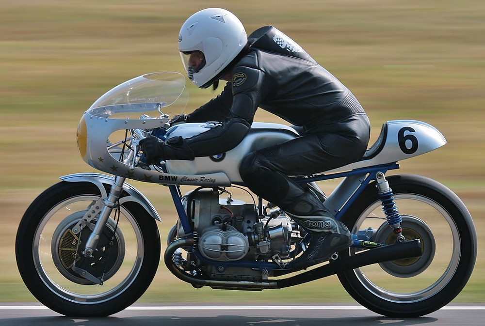a motorcycle racer on a classic bmw