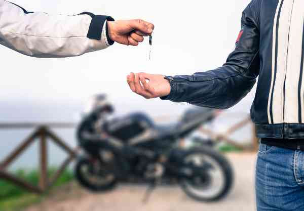 giving the keys of a motorcycle