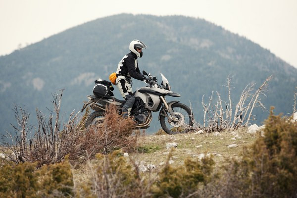 a rider riding in the mountains ona full gear