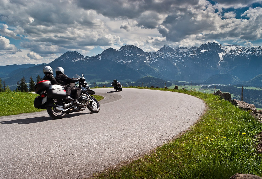 touring motorcycle with two riders taking a curve