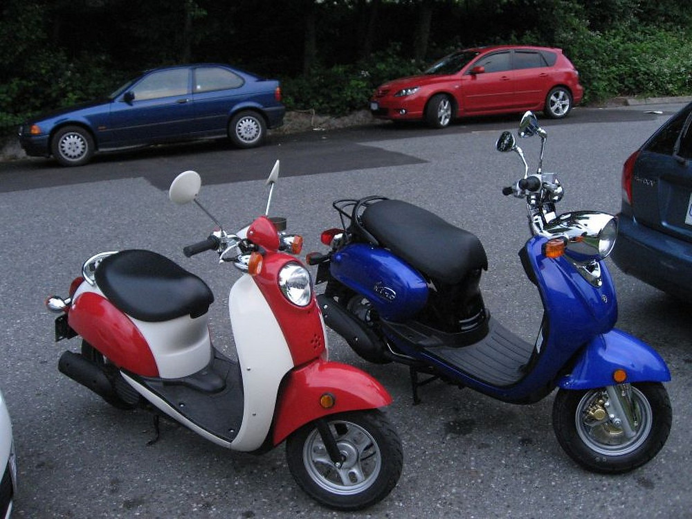 parked red and blue scooters