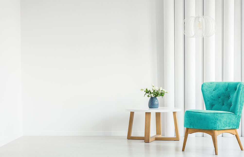 Canva - White living room with armchair.