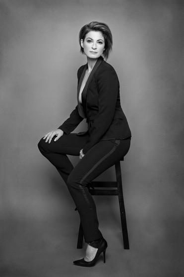 black suit sitting bw.jpg