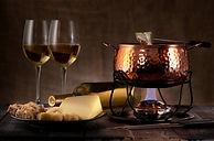 cheese fondue on rustic background.jpg