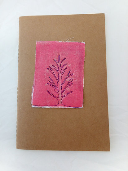 Notebook with lined paper, embroidered tree embellishments
