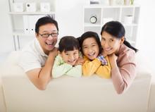 bigstock-Happy-Asian-Family-In-The-Livi-77215217.jpg