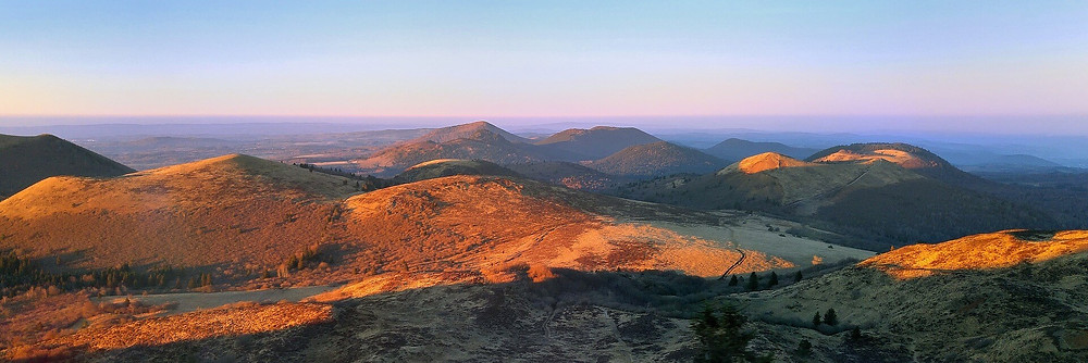 Volcans d'Auvergne The 'puys' of Auvergne are rounded hills formed by hardened magma from a chain of dormant volcanoes.