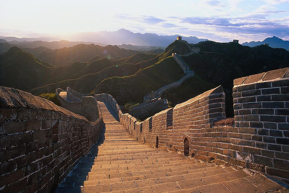 The Great Wall of China with mountain and sun view