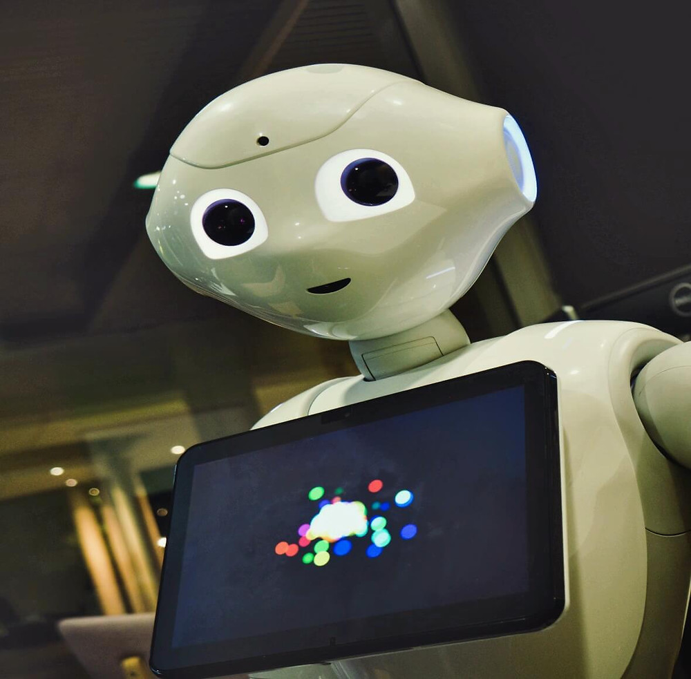 Ground-Breaking Robotics Vs Humankind - robot with a tablet interacting