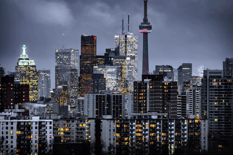 5 things to do in Canada - Toronto city night view with CN tower and skyscrapers