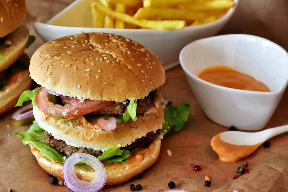 Junk food - multi layer hamburger with gravy and fries