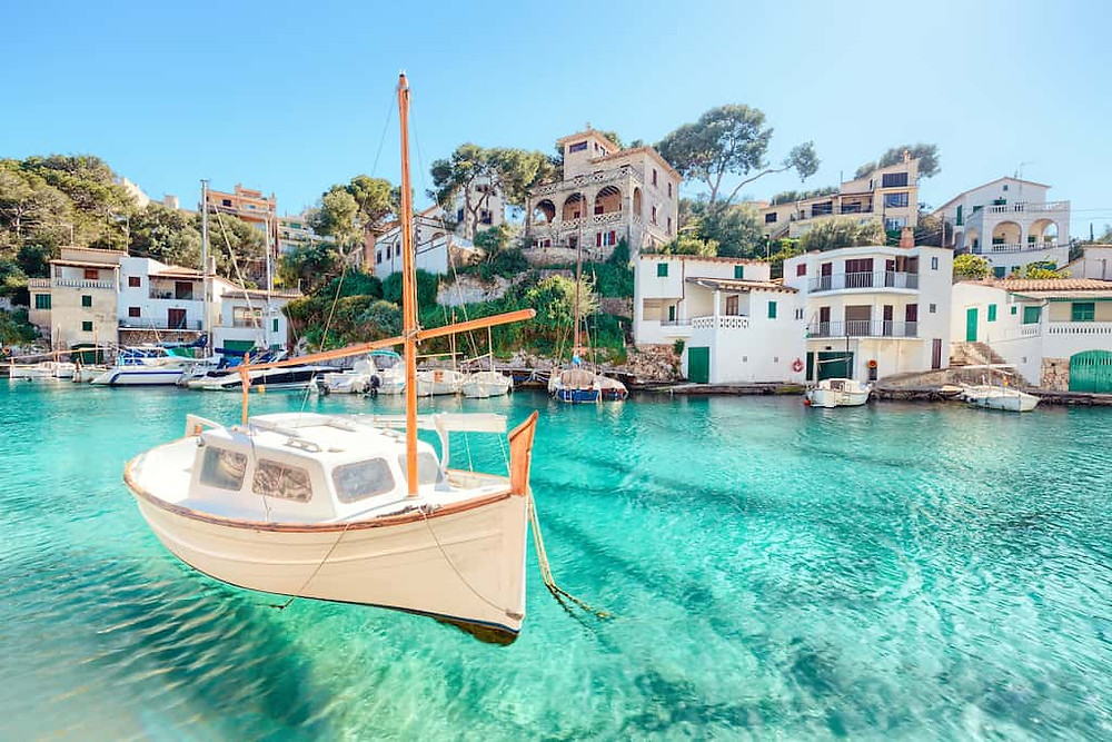 boat flowing on a crystal clean water in the south of Spain