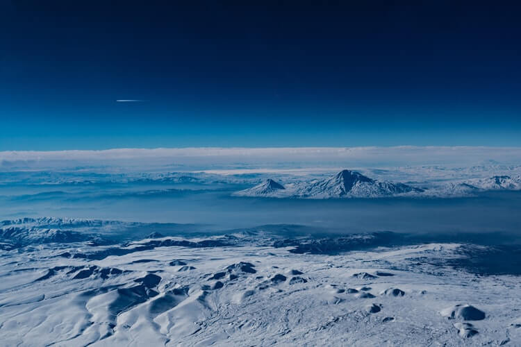Effects of Climate Change - air view with mountains covered in snow