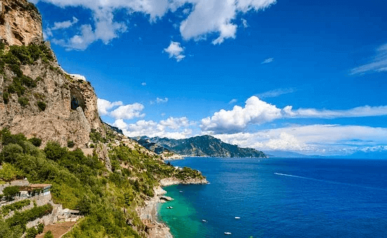 The Romagna Riviera mountain going into the sea with a blue sky with few clouds