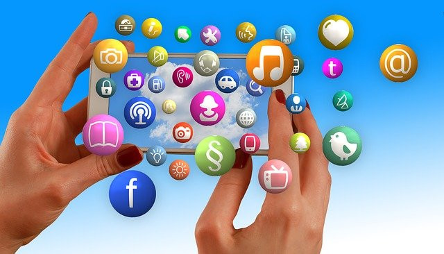 Social Media Power The Honest Review - tow hands holding a phone surround it by multiple icons