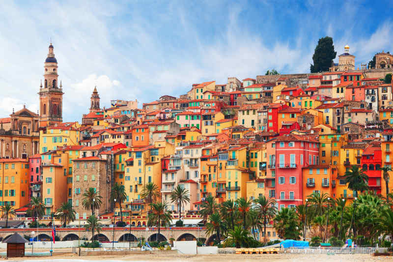 colorful buildings from France with a tower an a bridge