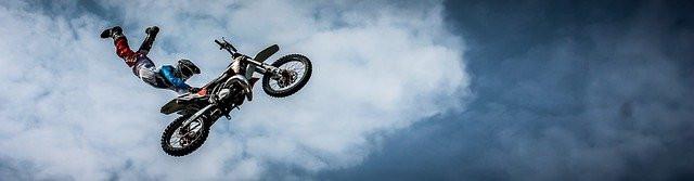 man-riding a dirt bike in a cloudy day