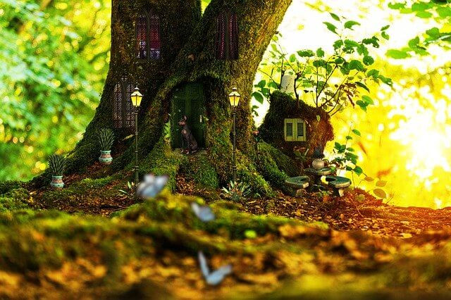 pet tree house with lights and plant pots, made in a tree