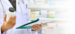 pharmacist-holding-medicine-bottle-and-c